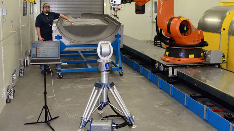 A Cirrus Aircraft worker uses a FARO Laser Tracker for robot and machine tool calibration