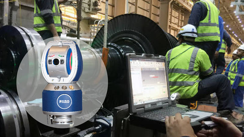 A laptop displaying a FARO 3D scan of a wind turbine with workers checking precision measurements in the background