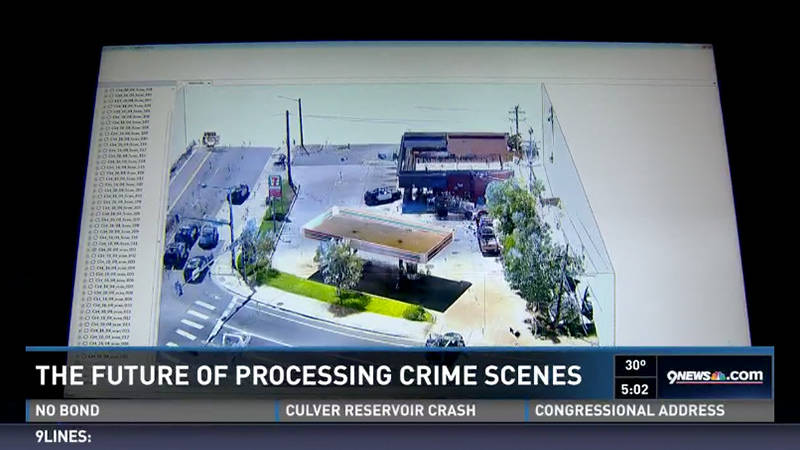 A 3D scanning image of a gas station on a TV news segment about the future of processing crime scenes